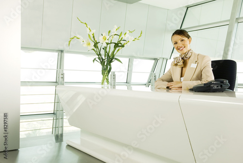 A receptionist sitting at a desk