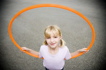 A young girl with a hoop