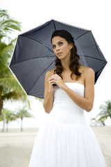A bride standing under an umbrella