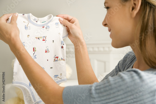 A mother holding a baby's vest