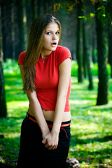 Surprised woman in a forest