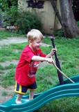 Four Year Old Boy in a Backyard Playground poster