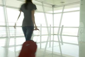 A woman walking through an airport