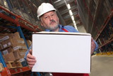 older worker in uniform  carrying parcel in warehouse poster