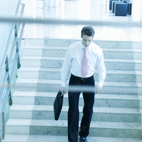 A businessman walking down stairs