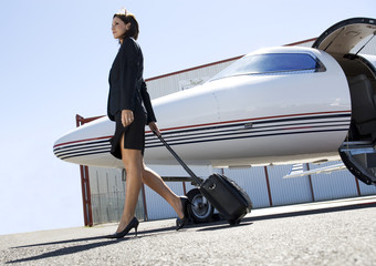 A business woman leaving a plane