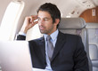 A businessman sitting on a plane