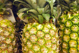 Selection of pineapples on display on market stall, close-up (full frame)