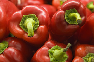 Selection of red bell peppers on display on market stall, close-up (full frame)
