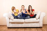 three girls sitting on a lounge are crying with tissues poster