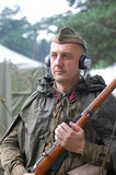 Russian soldier in earphones . WW2 reenacting poster