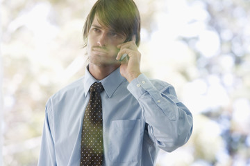 A businessman using a mobile phone
