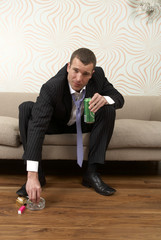Businessman drinking a can of lager and smoking