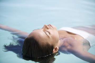 A woman floating in a pool