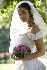 Portrait of a bride holding a bouquet
