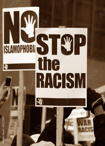 Muslim Protest And Protestors With Picket Signs stop racism