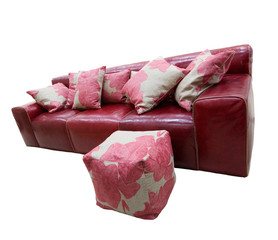 Red leather couch and puff