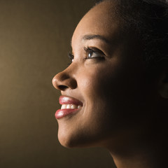 Profile of smiling young woman.