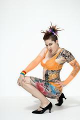 Tattooed woman squatting