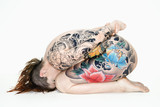 Nude tattooed woman on side poster