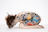 Nude tattooed woman poster