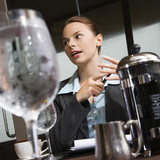 Businesswoman with beverages. poster