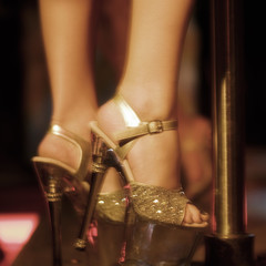 Close-up of a pole dancer's high heel shoes