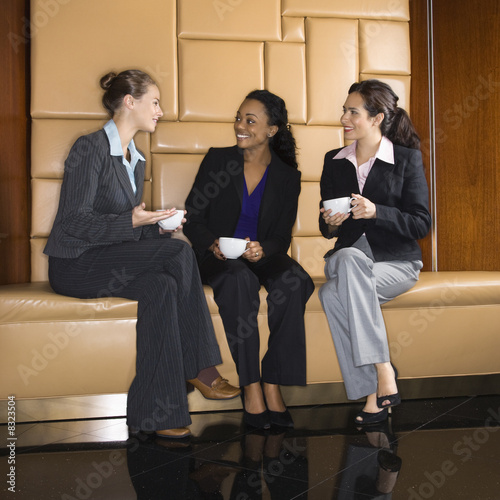 Businesswomen drinking coffee.