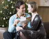 A couple reading Christmas cards