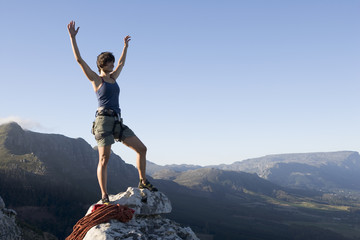 A climber celebrating reaching the top