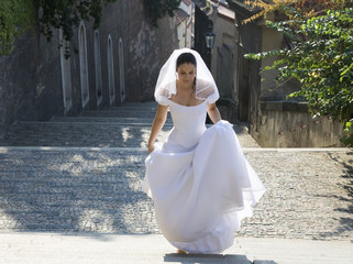 A bride walking up steps