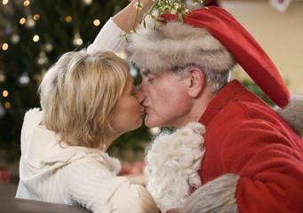 Santa Claus kissing his wife
