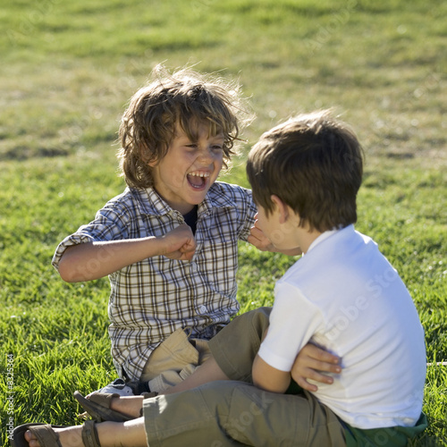 Two young boys playing
