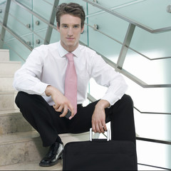 Portrait of a businessman sitting on steps