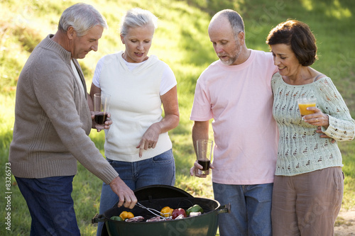 A group of senior friends having a barbeque