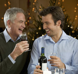 A father and son drinking wine