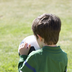 A young boy with a football