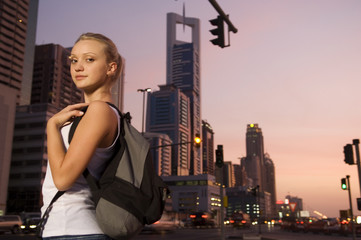 A young woman tourist in a city