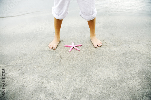 A young boy with a starfish