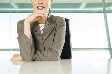 A businesswoman sitting at a table
