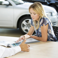 A young woman buying a new car