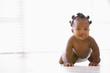 Baby crawling indoors