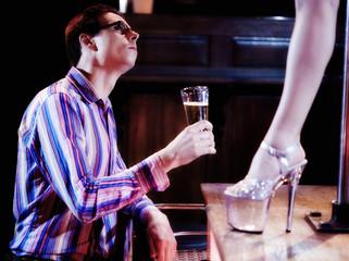 A man watching an erotic dancer