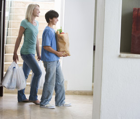 A mother and son coming home with the shopping