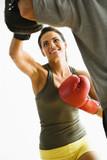 Woman punching poster