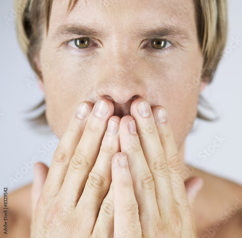 A male nude, hands over mouth
