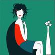 femme turquoise dans fauteuil