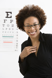 Woman with eye chart poster