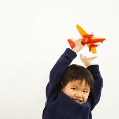 Boy playing airplane