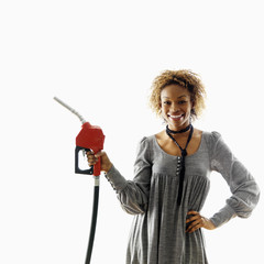 Smiling woman with petro hose